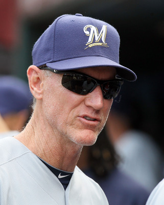 NEW YORK, NY - AUGUST 21:  Manager Ron Roenicke of the Milwaukee Brewers looks on against the New York Mets at Citi Field on August 21, 2011 in the Flushing neighborhood of the Queens borough of New York City. The Brewers defeated the Mets 6-2.  (Photo by