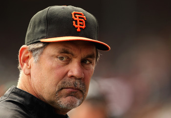 SAN FRANCISCO, CA - SEPTEMBER 04:  Manager Bruce Bochy of the San Francisco Giants stands in the dugout before their game against the Arizona Diamondbacks at AT&T Park on September 4, 2011 in San Francisco, California.  (Photo by Ezra Shaw/Getty Images)
