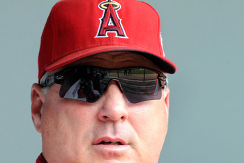 BALTIMORE, MD - SEPTEMBER 18:  Manager Mike Scioscia of the Los Angeles Angels of Anaheim sits in the dugout before a baseball game against the Baltimore Orioles at Oriole Park at Camden Yards on September 18, 2011 in Baltimore, Maryland. The Angels beat