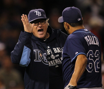 BOSTON, MA - SEPTEMBER 17:  Joe Maddon #70 of the Tampa Bay Rays celebrates with pitcher Joel Peralta #62, who earned a save, in a 4-3 win over the Boston Red Sox at Fenway Park September 17, 2011 in Boston, Massachusetts. (Photo by Jim Rogash/Getty Image