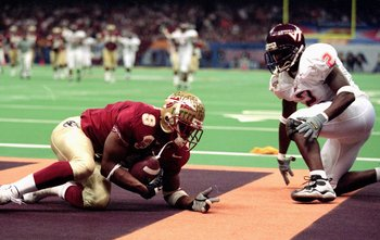 5 Jan 2000:  Peter Warrick #9 of the Florida State Seminoles makes a touchdown during the Nokita Sugar Bowl Game against the Virginia Tech Hokies at the Louisiana Superdome in New Orleans, Louisiana. The Seminoles defeated the Hokies 46-29. Mandatory Cred