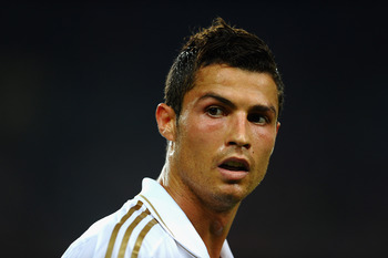 BARCELONA, SPAIN - AUGUST 17: Cristiano Ronaldo of Real Madridlooks on during the Super Cup second leg match between Barcelona and Real Madrid at Nou Camp on August 17, 2011 in Barcelona, Spain.  (Photo by Laurence Griffiths/Getty Images)