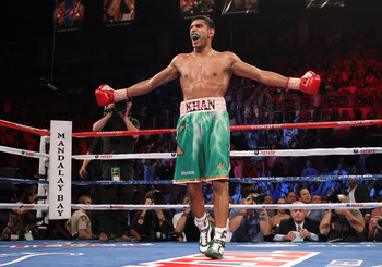 LAS VEGAS, NV - JULY 23:  Amir Khan celebrates his fifth round knockout of Zab Judah in their super lightweight world championship unification bout at Mandalay Bay Events Center on July 23, 2011 in Las Vegas, Nevada.  (Photo by Scott Heavey/Getty Images)