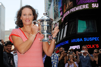 NEW YORK, NY - SEPTEMBER 12:  Samantha Stosur of Australia, the 2011 U.S. Open Champion, poses with the trophy in Times Square on September 12, 2011 in New York City. Stosur defeated Serena Williams of the United States, 6-2, 6-3.  (Photo by Patrick McDer