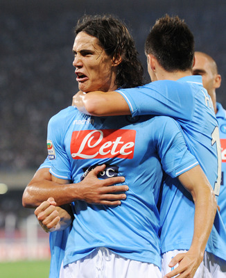 NAPLES, ITALY - SEPTEMBER 18:  Edinson Cavani of Napoli celebrates after scoring the  goal  1-1 during the Serie A match between SSC Napoli and AC Milan at Stadio San Paolo on September 18, 2011 in Naples, Italy.  (Photo by Giuseppe Bellini/Getty Images)