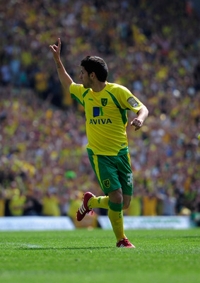 NORWICH, ENGLAND - MAY 07:  Dani Pacheco of Norwich City celebrates his goal during the npower Championship match between Norwich City and Coventry City at Carrow Road on May 7, 2011 in Norwich, England.  (Photo by Jamie McDonald/Getty Images)