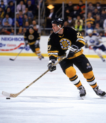 1990:  Right wing Dave Christian #27 of the Boston Bruins moves the puck against the Buffalo Sabres during a 1990 season game.  (Photo by Rick Stewart/Getty Images)