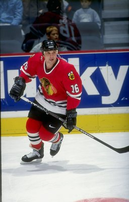 28 Nov 1998: Leftwinger Ed Olczyk #16 of the Chicago Blackhawks in action during the game against the Calgary Flames at the Canadian Airlines Saddledome in Calgary, Alberta, Canada. The Flames defeated the Blackhawks 5-4.