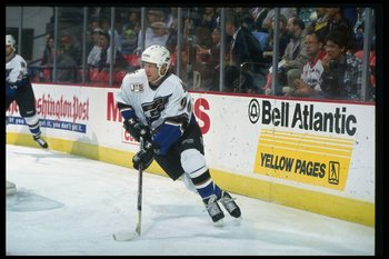 19 Nov 1996:  Defenseman Phil Housley of the Washington Capitals moves down the ice during a game against the Boston Bruins at the USAir Arena in Landover, Maryland.  The game was a tie, 2-2. Mandatory Credit: Doug Pensinger  /Allsport