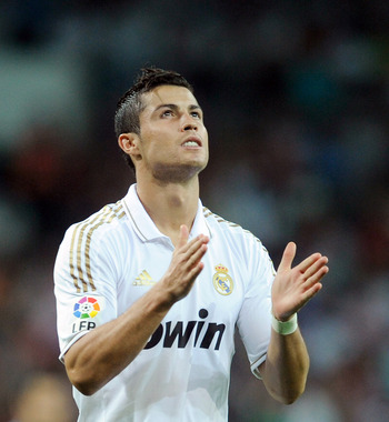 MADRID, SPAIN - SEPTEMBER 10:  Cristiano Ronaldo of Real Madrid applauds during the La Liga match bewteen Real Madrid and Getafe at Estadio Santiago Bernabeu on September 10, 2011 in Madrid, Spain.  (Photo by Denis Doyle/Getty Images)