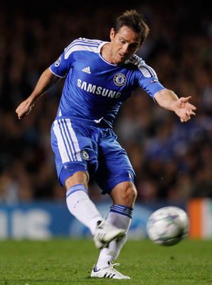 LONDON, ENGLAND - SEPTEMBER 13:  Frank Lampard of Chelsea kicks the ball during the UEFA Champions League Group E match between Chelsea and Bayer 04 Leverkusen at Stamford Bridge on September 13, 2011 in London, England.  (Photo by Paul Gilham/Getty Image