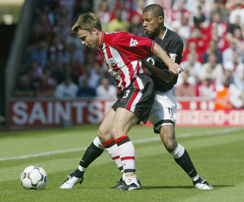 LONDON - AUGUST 31:  Graeme Le Saux of Southampton holds off Kleberson of Manchester United during the FA Barclaycard Premiership match between Southampton and Manchester United at The Friends Provident St Mary's Stadium on August 31, 2003 in London. (Pho