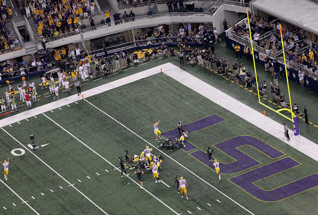 ARLINGTON, TX - SEPTEMBER 03:  Michael Ford #42 of the LSU Tigers scores a touchdown against the Oregon Ducks at Cowboys Stadium on September 3, 2011 in Arlington, Texas.  (Photo by Ronald Martinez/Getty Images)
