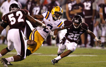 STARKVILLE, MS - SEPTEMBER 15:  wide receiver Rueben Randle #2 of the LSU Tigers runs between linebacker Ferlando Bohanna #52 of the Mississippi State Bulldogs and defensive back Corey Broomfield #25 of the Mississippi State Bulldogs for a first down in t