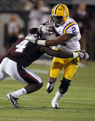 STARKVILLE, MS - SEPTEMBER 15:  Wide receiver Rueben Randle #2 of the LSU Tigers tries to break through the tackle of defensive back Charles Mitchell #4 of the Mississippi State Bulldogs in the fourth quarter on September 15, 2011 at Davis Wade stadium in
