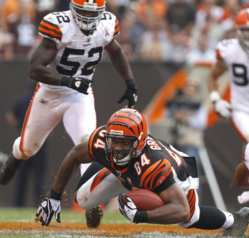 CLEVELAND, OH - SEPTEMBER 11:  Tight end Jermaine Gresham #84 of the Cincinnati Bengals dives for extra yardage in front of linebacker D'Qwell Jackson #52 of the Cleveland Browns during the season opener  at Cleveland Browns Stadium on September 11, 2011