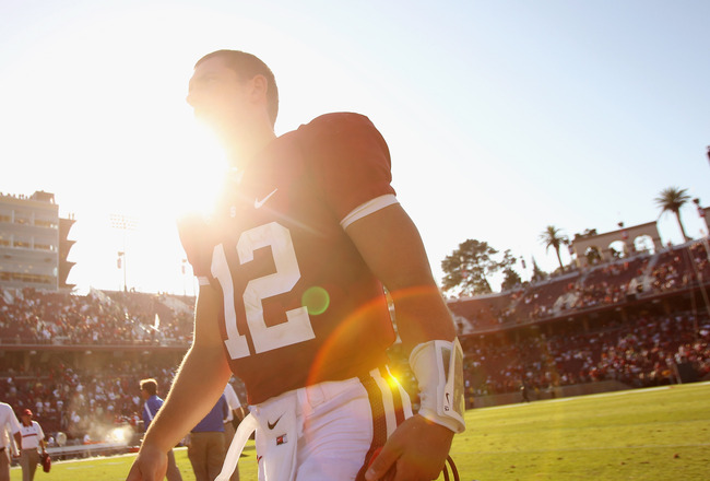 STANFORD, CA - SEPTEMBER 03:  Andrew Luck #12 of the Stanford Cardinal walks off the field after their game against the San Jose State Spartans at Stanford Stadium on September 3, 2011 in Stanford, California.  (Photo by Ezra Shaw/Getty Images)