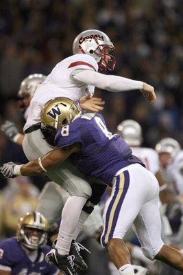 SEATTLE - NOVEMBER 28: Quarterback Marshall Lobbestael #8 of the Washington State Cougars is sacked by Nate Williams #8 of the Washington Huskies on November 28, 2009 at Husky Stadium in Seattle, Washington. The Huskies defeated the Cougars 30-0. (Photo b