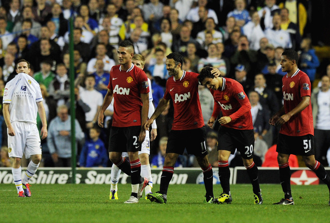 LEEDS, ENGLAND - SEPTEMBER 20:  Ryan Giggs of Manchester United celebrates with Fabio Da Silva after scoring his team's third goal during the Carling Cup Third Round match between Leeds United and Manchester United at Elland Road on September 20, 2011 in 