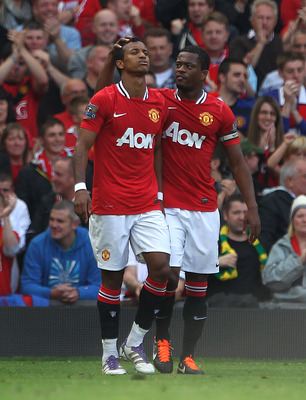 MANCHESTER, ENGLAND - SEPTEMBER 18:  Nani of Manchester United celebrates scoring his team's second goal with team mate Patrice Evra (R) during the Barclays Premier League match between Manchester United and Chelsea at Old Trafford on September 18, 2011 i