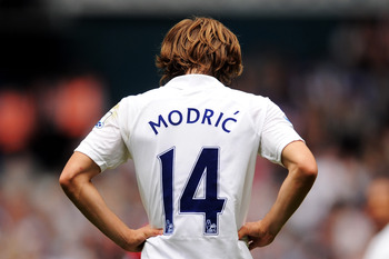 LONDON, ENGLAND - AUGUST 28:  Luka Modric of Tottenham looks down dejected during the Barclays Premier League match between Tottenham Hotspur and Manchester City at White Hart Lane on August 28, 2011 in London, England.  (Photo by Michael Regan/Getty Imag