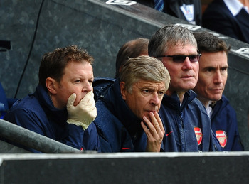 BLACKBURN, ENGLAND - SEPTEMBER 17: Arsene Wenger of Arsenal shows his dissapointment from the bench during the Barclays Premier League match between Blackburn Rovers and Arsenal at Ewood Park on September 17, 2011 in Blackburn, England.  (Photo by Laurenc