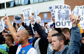 BLACKBURN, ENGLAND - SEPTEMBER 17: Blackburn fans march outside the stadium to show their dissaproval of Manager Steve Kean during the Barclays Premier League match between Blackburn Rovers and Arsenal at Ewood Park on September 17, 2011 in Blackburn, Eng