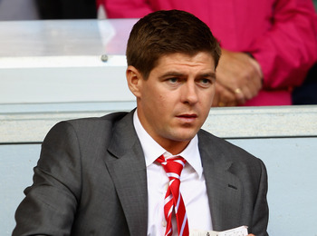 LIVERPOOL, ENGLAND - AUGUST 27:  Injured Steven Gerrard of Liverpool looks on from the stand ahead of the Barclays Premier League match between Liverpool and Bolton Wanderers at Anfield on August 27, 2011 in Liverpool, England.  (Photo by Clive Brunskill/
