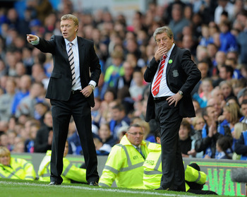 LIVERPOOL, ENGLAND - OCTOBER 17: Everton manager David Moyes gestures as Liverpool manager Roy Hodgson looks on during the Barclays Premier League match between Everton and Liverpool at Goodison Park on October 17, 2010 in Liverpool, England.  (Photo by M