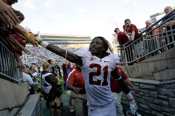 STATE COLLEGE, PA - SEPTEMBER 10:  Dre Kirkpatrick #21 of the Alabama Crimson Tide celebrates with fans after the Crimson Tide's win over Penn State Nittany Lions at Beaver Stadium on September 10, 2011 in State College, Pennsylvania.  (Photo by Rob Carr/