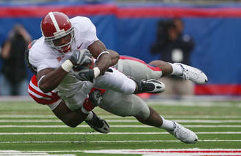 OXFORD, MS - OCTOBER 10:  Mark Baron #4 of the Alabama Crimson Tide runs for a first down on a fake punt as Joel Kight #49 of the Mississippi Rebels defens during their college football game at Vaught-Hemingway Stadium on October 10, 2009 in Oxford, Missi