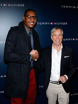 NEW YORK, NY - SEPTEMBER 11:  NBA player Carmelo Anthony and designer Tommy Hilfiger pose backstage at the Tommy Hilfiger Spring 2012 fashion show during Mercedes-Benz Fashion Week at The Theater at Lincoln Center on September 11, 2011 in New York City.