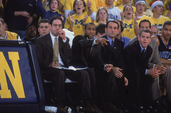 8 Dec 2001:  Portrait of head coach Mike Kryzewski and assistant coach Johnny Dawkins of the Duke Blue Devils during the NCAA basketball game against the Michigan Wolverines at Crisler Arena in Ann Arbor, Michigan.  Duke defeated Michigan 104-83.  Mandato
