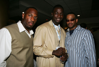 JACKSONVILLE, FL - FEBRUARY 05: (L to R)  College linebacker Kirk Morrison, college quarterback Adrian McPherson and ESPN Sportscenter host, Stuart Scott pose for a photo during the Leigh Steinberg Annual Super Bowl Event on February 5, 2005 at Times Unio