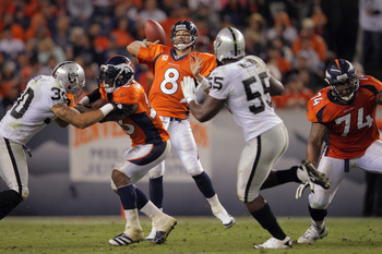 DENVER, CO - SEPTEMBER 12:  Quarterback  Kyle Orton #8 of the Denver Broncos delivers a pass against the Oakland Raiders at Sports Authority Field at Mile High on September 12, 2011 in Denver, Colorado.  (Photo by Doug Pensinger/Getty Images)