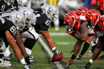 OAKLAND, CA - NOVEMBER 22:  Samson Satele #64 of the Oakland Raiders prepares to snap the ball during their game against the Cincinnati Bengals at Oakland-Alameda County Coliseum on November 22, 2009 in Oakland, California.  (Photo by Ezra Shaw/Getty Imag