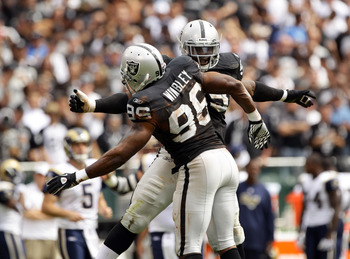 OAKLAND, CA - SEPTEMBER 19:  Lamarr Houston #99 is congratulated by Kamerion Wimbley #96 of the Oakland Raiders after Houston sacked Sam Bradford #8 of the St. Louis Rams at the Oakland-Alameda County Coliseum on September 19, 2010 in Oakland, California.