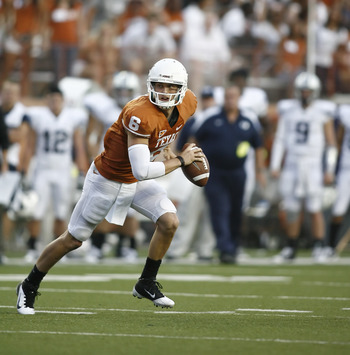AUSTIN, TX - SEPTEMBER 10:  Backup quarterback Case McCoy #6 of the Texas Longhorns scrambles against the BYU Cougars on September 10, 2011 at Darrell K. Royal-Texas Memorial Stadium in Austin, Texas.  Texas defeated BYU 17-16.  (Photo by Erich Schlegel/G