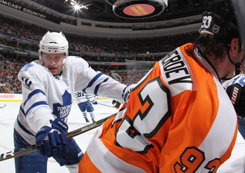 PHILADELPHIA - MARCH 03:  Nikolay Zherdev #93 of The Philadelphia Flyers is checked by Luke Schenn #2 the Toronto Maple Leafs during their game on March 3, 2011 at The Wells Fargo Center in Philadelphia, Pennsylvania.  (Photo by Al Bello/Getty Images)