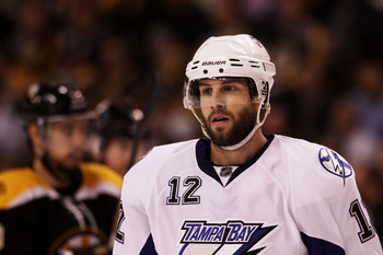 BOSTON, MA - MAY 17:  Simon Gagne #12 of the Tampa Bay Lightning looks on in Game Two of the Eastern Conference Finals against the Boston Bruins during the 2011 NHL Stanley Cup Playoffs at TD Garden on May 17, 2011 in Boston, Massachusetts.  (Photo by Bru