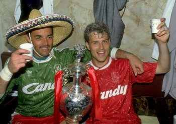 1 May 1990:  Bruce Grobbelaar (left) and Glenn Hysen of Liverpool celebrate with the trophy after the Barclays League Division One match against Derby County at Anfield in Liverpool, England. Liverpool won the match 1-0 and became league champions. \ Mand