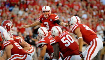 LINCOLN, NE - SEPTEMBER 10: Taylor Martinez #3 of the Nebraska Cornhuskers organizes his offense during their game against Fresno State at Memorial Stadium September 10, 2011 in Lincoln, Nebraska. Nebraska won 42-29.(Photo by Eric Francis/Getty Images)