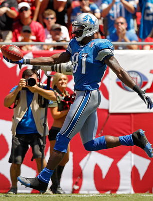 TAMPA, FL - SEPTEMBER 11:  Calvin Johnson #81 of the Detroit Lions scores a touchdown during the season opener against the Tampa Bay Buccaneers at Raymond James Stadium on September 11, 2011 in Tampa, Florida.  (Photo by Mike Ehrmann/Getty Images)