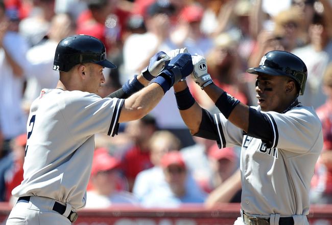 ANAHEIM, CA - SEPTEMBER 11:  Curtis Granderson #14 of the New York Yankees celebrates his two run homerun with Derek Jeter #2 to trail 5-4 against the Los Angeles Angels of Anaheim during the fifth inning at Angel Stadium of Anaheim on September 11, 2011