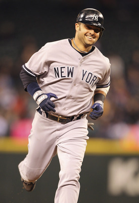 SEATTLE - SEPTEMBER 14:  Nick Swisher #33 of the New York Yankees smiles as he rounds third base after hitting a solo homerun in the seventh inning against the Seattle Mariners at Safeco Field on September 14, 2011 in Seattle, Washington. (Photo by Otto G