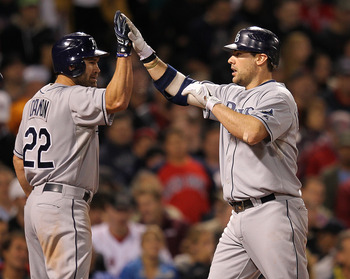 BOSTON, MA - SEPTEMBER 15: Casey Kotchman #11 of the Tampa Bay Rays celebrates his home run with Johnny Damon #22 of the Tampa Bay Rays, who was on base, against the Boston Red Sox in the sixth inning at Fenway Park September 15, 2011 in Boston, Massachus