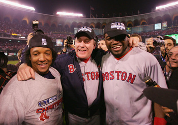 ST LOUIS - OCTOBER 27:  (L-R) Pedro Martinez #45, Curt Schilling #38 and David Ortiz 34 of the Boston Red Sox celebrate after defeating the St. Louis Cardinals 3-0 in game four of the World Series on October 27, 2004 at Busch Stadium in St. Louis, Missour