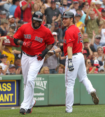 BOSTON, MA - AUGUST 27:  David Ortiz #34 of the Boston Red Sox celebrates with Josh Reddick #16 of the Boston Red Sox and smiles after scoring on a sacrifice fly against the Oakland Athletics in the third inning  at Fenway Park August 27, 2011 in Boston,