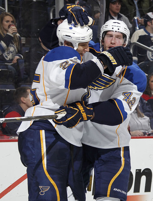 COLUMBUS, OH - MARCH 09:  Chris Stewart #25 of the St. Louis Blues celebrates his third-period goal with teammate David Backes #42 while playing the Columbus Blue Jackets on March 9, 2011 at Nationwide Arena in Columbus, Ohio.  (Photo by Gregory Shamus/Ge
