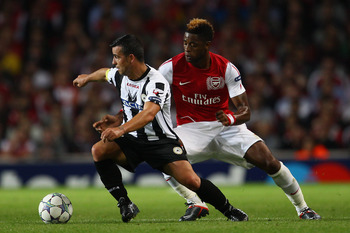 LONDON, ENGLAND - AUGUST 16:  Antonio Di Natale of Udinese iis closed down by Alex Song of Arsenal during the UEFA Champions League play-off first leg match between Arsenal and Udinese at the Emirates Stadium on August 16, 2011 in London, England.  (Photo